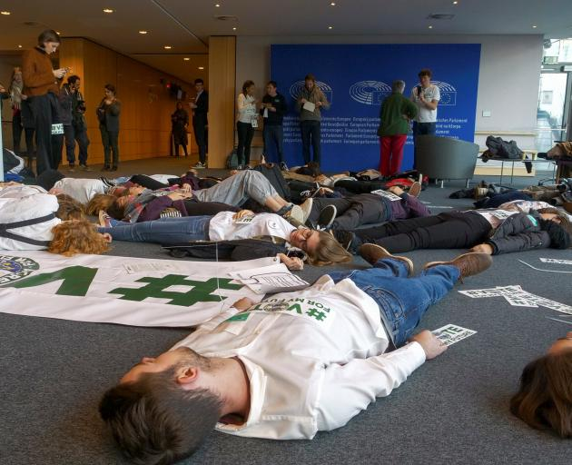 Youth for Climate activists  stage a die-in to demand more ambitious climate change goals by EU...