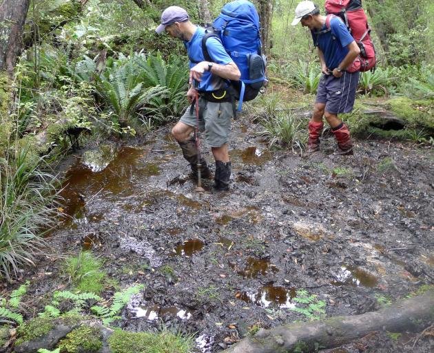 Geoff Plunket (left) and Jeff Cleugh (right) in one of the mud holes.