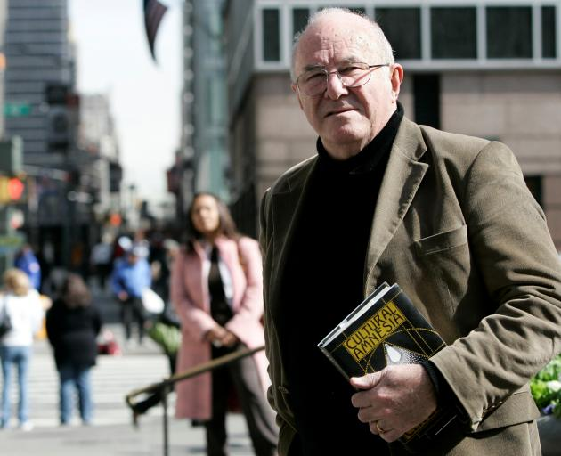 Author Clive James poses with copy of his book 'Cultural Amnesia' in New York. Photo: Reuters