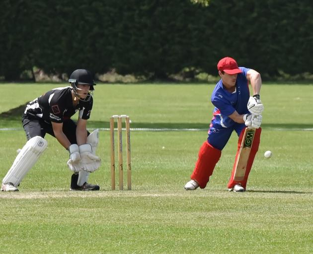 Leeston-Southbridge opener Rupert Young pushes forward during his innings of 77 as Cheviot wicket...