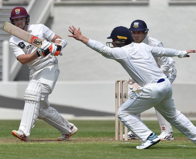 Northern Districts opening batsman Henry Cooper plays a shot as Otago's Nick Kelly reaches for...