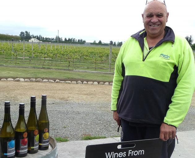 CharRees owner Charlie Hill with a selection of bottled wine made from grapes grown in Ashburton's only vineyard. File Photo