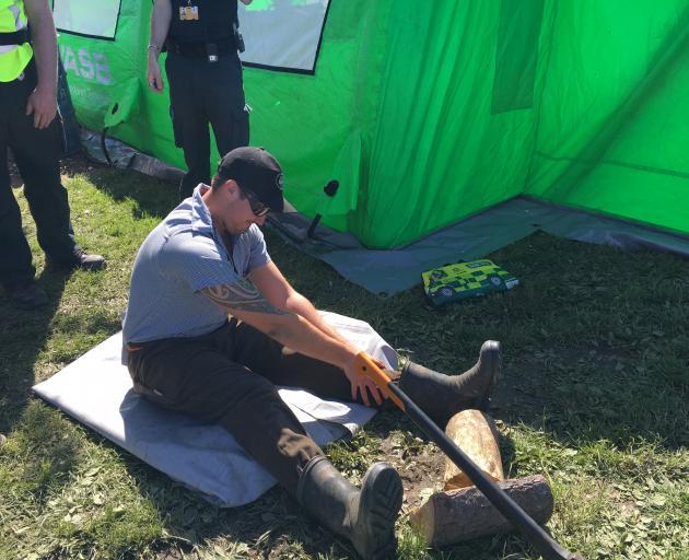 Waimakariri Young Farmers' Club member Ryan Hawes models for the St John first aid module during...