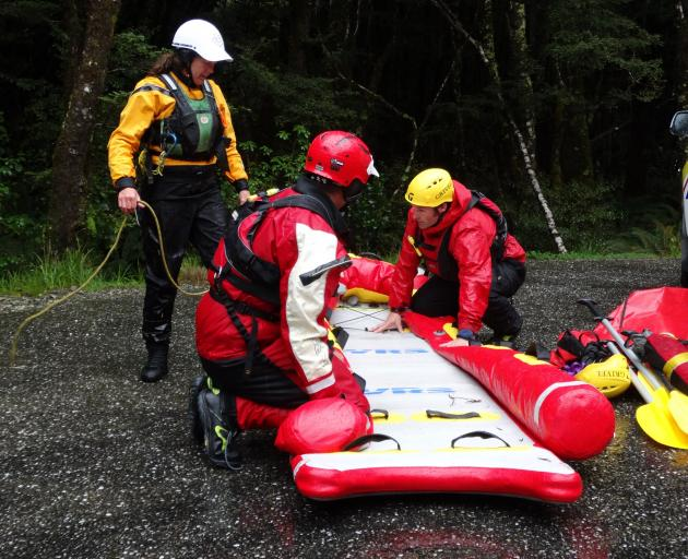 Members of the Wanaka swift water rescue team Dave Cassaidy (front), Rachel Moore (standing) and...