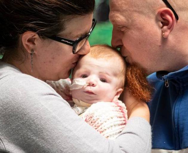 Proud parents Yulia Emanova and Konstantin Emanov with 3-and-half-month-old daughter Eva Emanova....