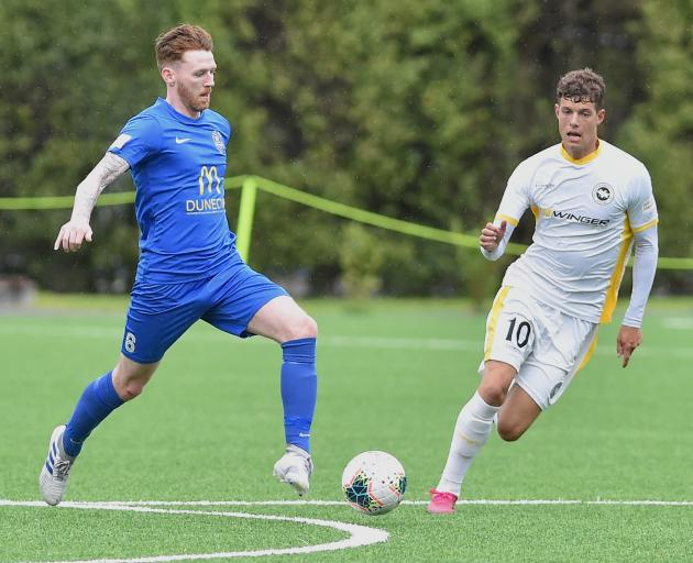 Southern United striker Garbhan Coughlan (left) looks to move the ball on in front of Eastern...