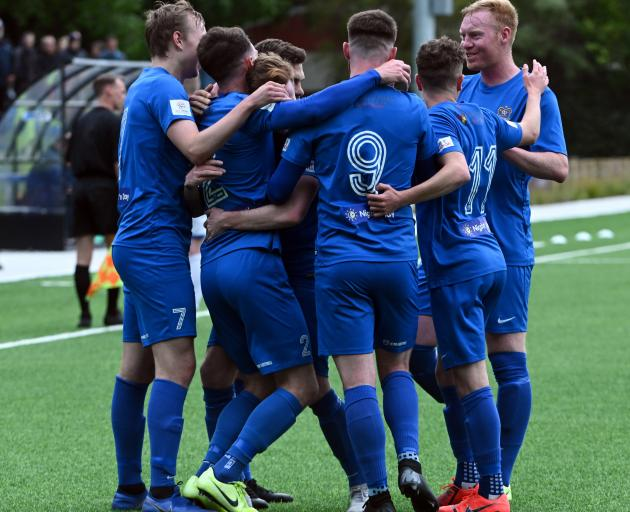 Southern United players congratulate captain Conor O'Keeffe (second left) after he scored his...