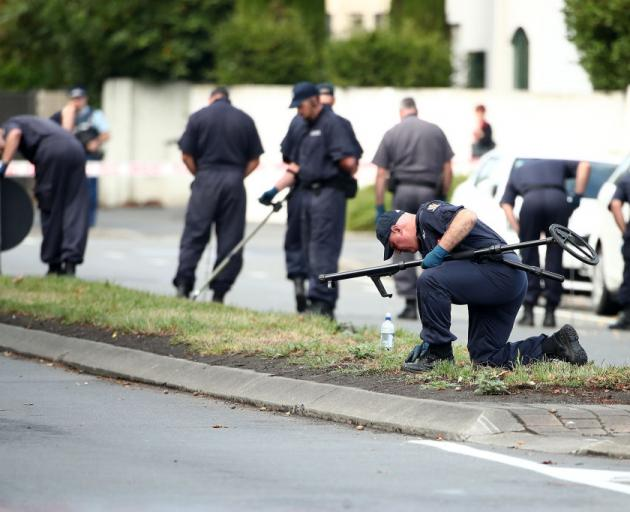 Police search for evidence on Deans Ave near the Al Noor Mosque after the terror attack. Photo:...