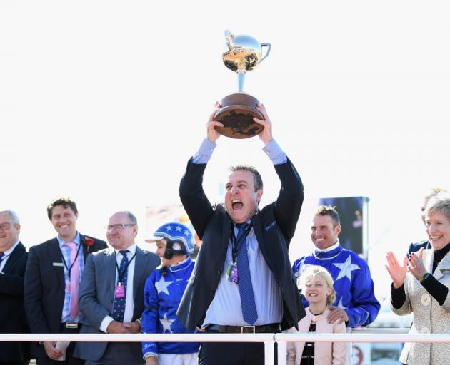 Owner of Cruz Bromac Danny Zavitsanos lifts the New Zealand Cup yesterday. Photo: Getty Images