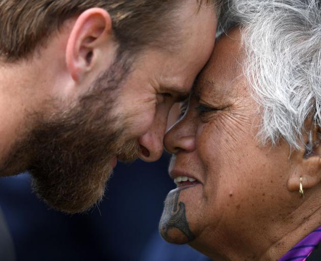 England captain Joe Root (left) and New Zealand captain Kane Williamson take part in a hongi during a Maori welcome ceremony at Bay Oval in Mount Maunganui yesterday. Photo: Getty Images