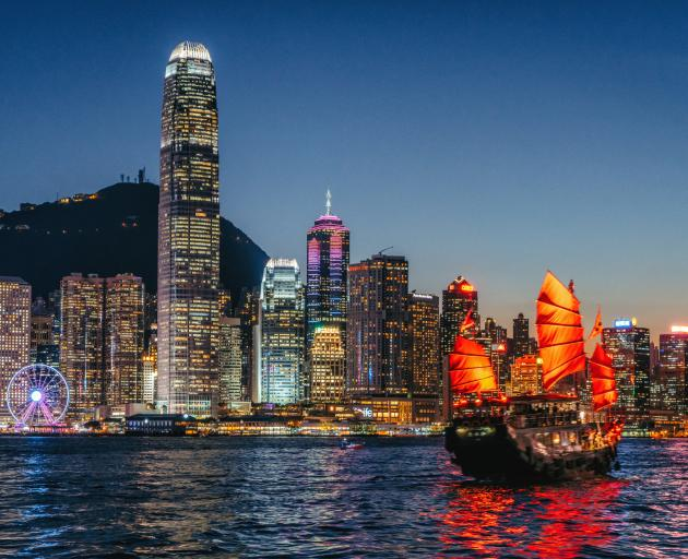 Cityscape Hong Kong and Junkboat at Twilight. Photo: Getty Images