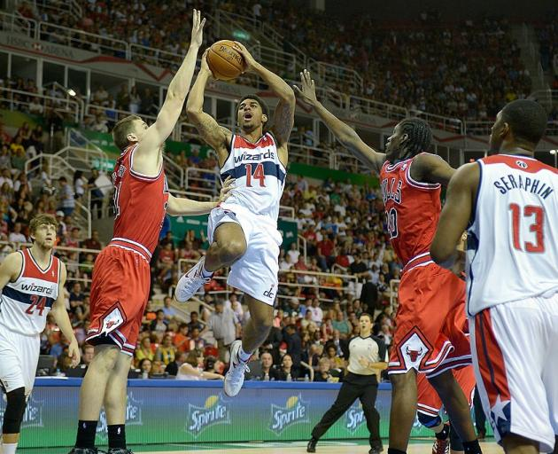 New Breakers signing Glen Rice Jr takes the ball to the hoop for the Washington Wizards against...