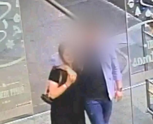 An image from CCTV footage viewed in court today showing the defendant and Grace Millane entering CityLife at 9.40pm. Photo: Supplied