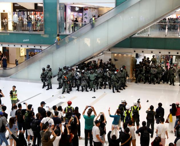 Shoppers and anti-government protesters gather at New Town Plaza in Sha Tin, Hong Kong. Photo: Reuters