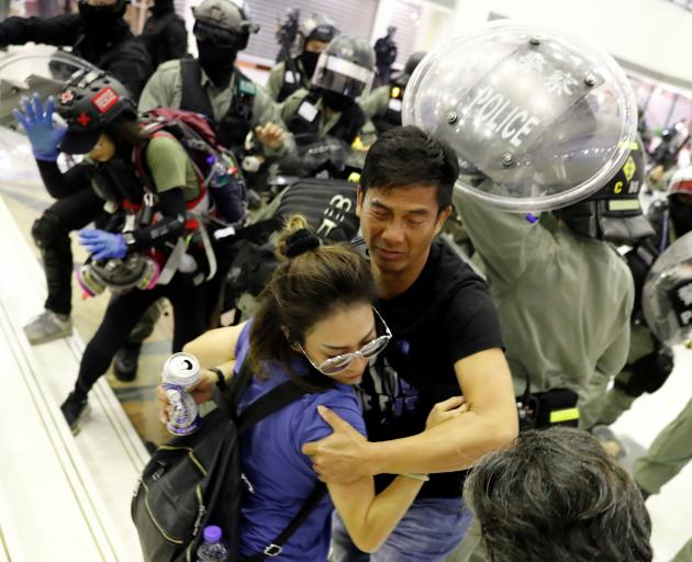 People scuffle with riot police at a shopping mall in Tai Po in Hong Kong. Photo: Reuters