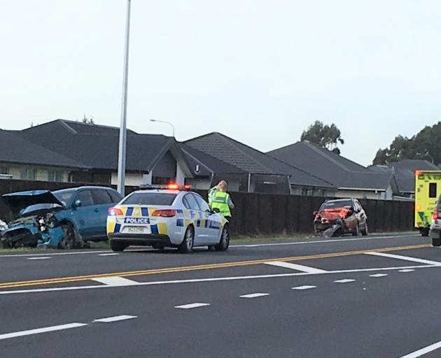 Police and ambulance were at the scene of two-car crash. Photo: David Hill