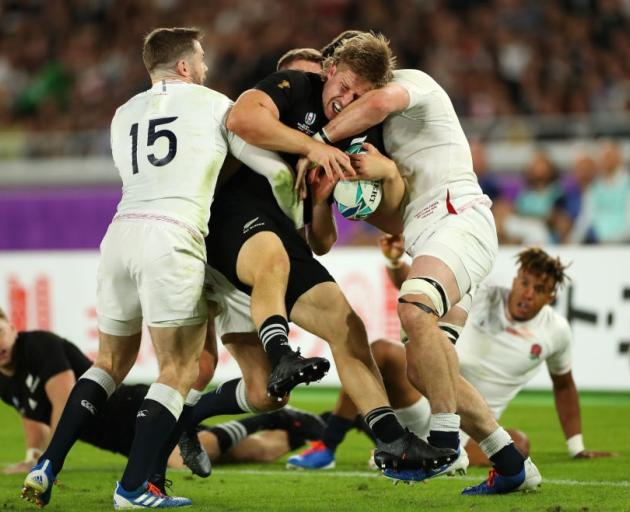 Jack Goodhue his smashed by the England defence during the All Blacks' World Cup semifinal loss....
