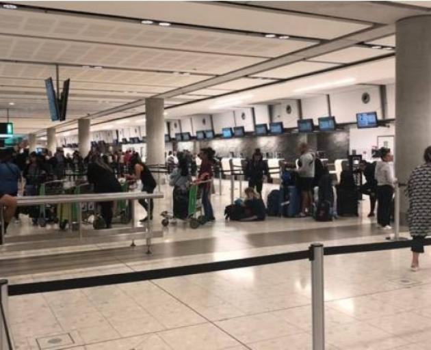 Passengers wait at Christchurch Airport at 3am on Monday after their Sydney-Auckland Jetstar...