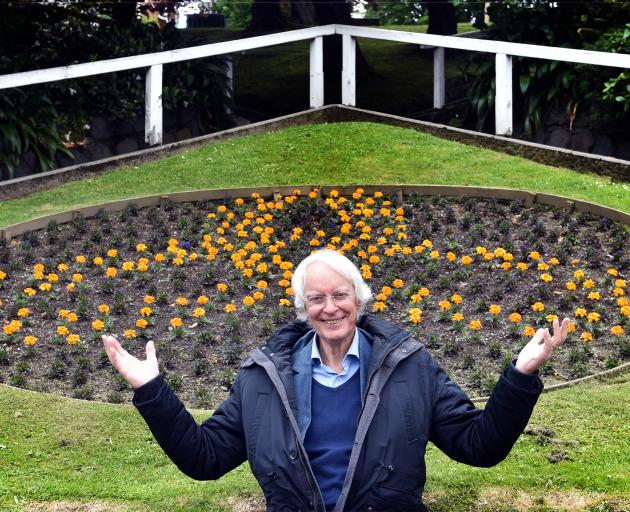 Showing off the site of the planned Archibald Baxter Peace Garden yesterday is Prof Kevin...