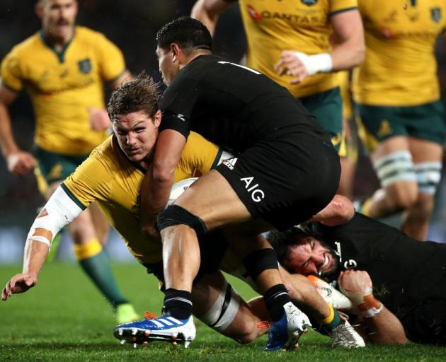 Australian flanker Michael Hooper is tackled during this year's Bledisloe Cup series against the...