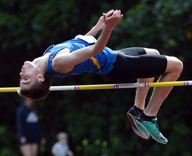 Tokomairiro High School pupil Millar McElrea competes in the high jump at the Caledonian Ground last Saturday. Photo: Gerard O'Brien