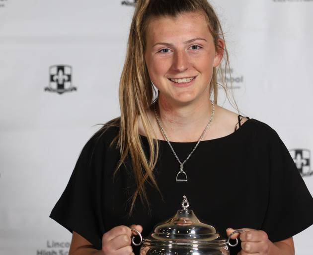 Millie Thompson's efforts in equestrian, hockey and touch rugby helped her be named sportsperson...