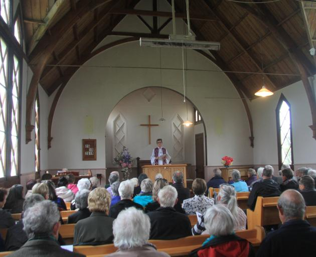 The Rev Rose Luxford leads the service.