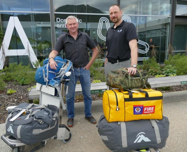 Southern District Deputy Principal Rural Fire Officer Hamish Angus, of Te Anau, left, and...