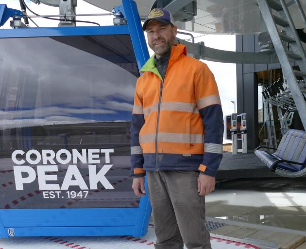 Coronet Peak maintenance head of department Ants Webb pictured with one of the skifield's new...