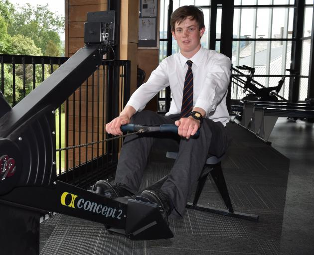 Mark Smith (15) has a go on a rowing erg at John McGlashan College this week after setting a world record earlier this month. Photo: Gregor Richardson