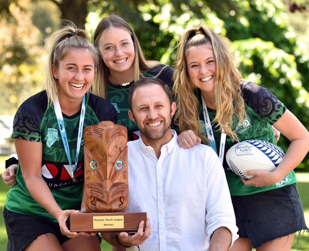 Celebrating winning a national touch title are (from left) Meg Sycamore (18), McKayler Moore (19)...
