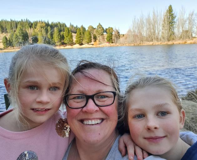 Selfies are often the only way mums can get themselves in the photo. Debbie pictured here with Laura (7) left, and Grace (10). Photos: Supplied