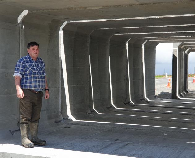 Jim MacDonald stands inside the concrete panels that are soon to be installed as a stock...