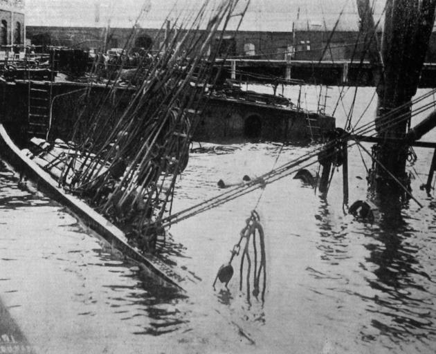 The Union Steam Ship's collier, Karori, with her decks awash at Birch Street wharf Dunedin. -...