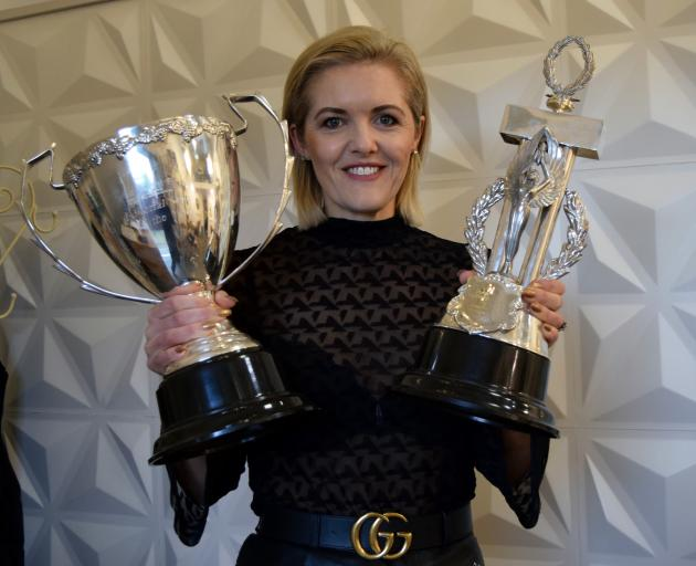 Moha Hairdressing co-owner Kylie Hayes displays two of the six trophies she won at The Industry Awards — editorial stylist of the year (left) and the Derek Elvy visionary award — in her salon in St Kilda yesterday. PHOTO: SHAWN MCAVINUE