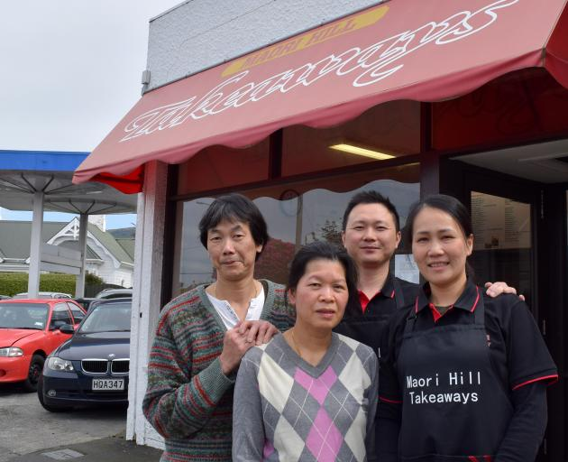 Maori Hill Takeaways former owners Chingwah (left) and Alice Cheung (second from left) and new owners Jimmy Huang and Cindy Zhu. PHOTO: SHAWN MCAVINUE