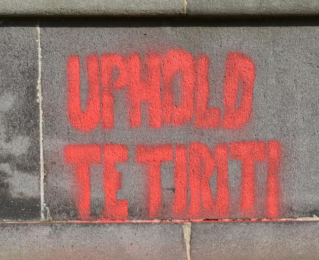 ''Uphold Te Tiriti [the Treaty]'' was painted on the statue.