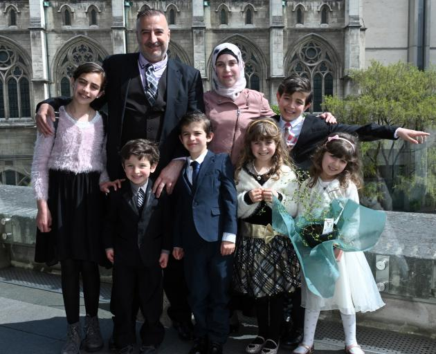 Mouhannad Taha and Lina Alhaj Shahin with their children (from left) Zenah (12), Ahmad (4), Faek (8) Noor (9), Mouhammad Ali (11) and Heba Taha (6) after a citizenship ceremony, in Dunedin yesterday. Photo: Linda Robertson