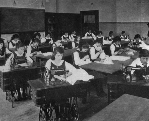 A sewing and dressmaking class at King Edward Technical College. - Otago Witness, 11.11.1919.