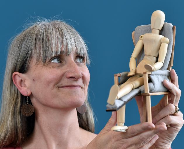 Otago Polytechnic second-year student Toni Linington views her product design of a chair to...