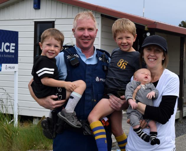 Constable Allan Lynch, his wife Kirsty and sons (from left) Ollie, Richie and Fergus outside Middlemarch police station last week. PHOTO: SHAWN MCAVINUE