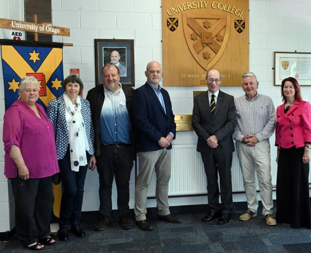Standing with the plaque which was unveiled for University College's 50th anniversary are (from...