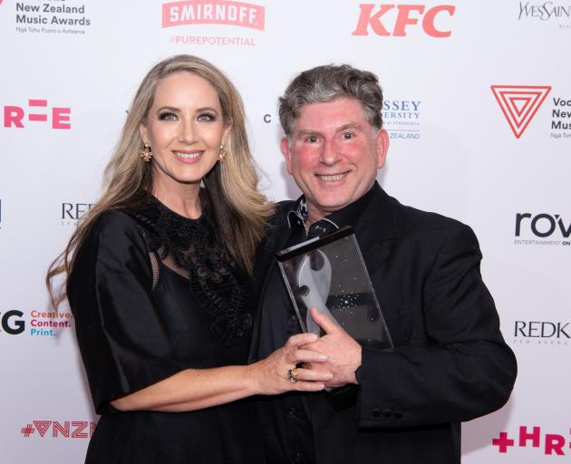 Carmel Walsh, wife of Simon O'Neill, and Professor Terence Dennis hold the award for best...