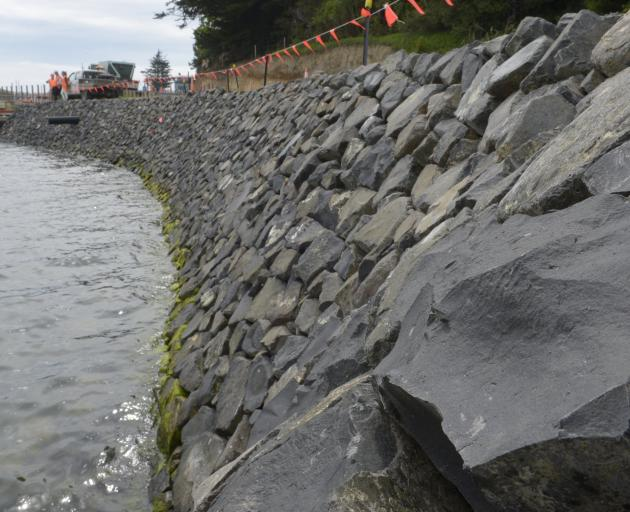 Interlocked rocks on a completed section of the wall.