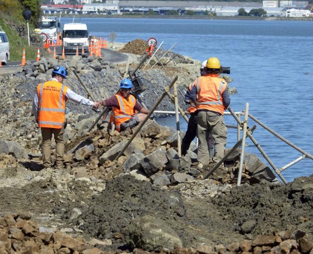 Contractors work on the wall in Portobello Rd.