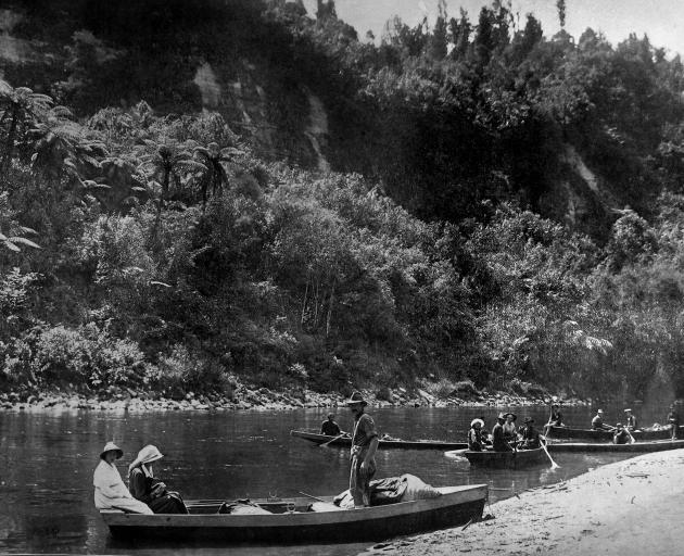 Members of a party boating down the Wanganui River from Taumarunui to Wanganui. - Otago Witness,...