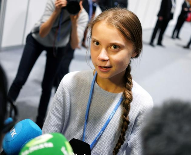 Climate change activist Greta Thunberg speaks to media during the COP25 climate summit in Madrid....