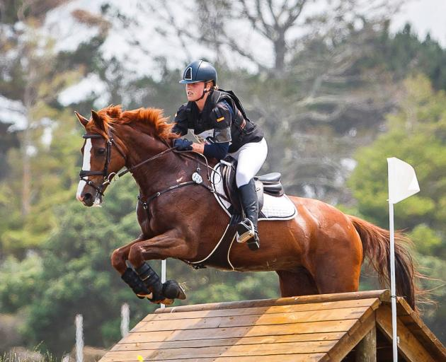 Ella Morshuis and her horse World Famous clear a cross-country obstacle at the Puhinui three-day...