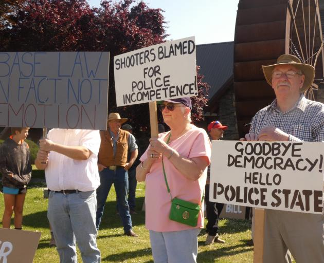 Dozens of residents gathered at Alexandra's Pioneer Park on Saturday to protest the Government's...