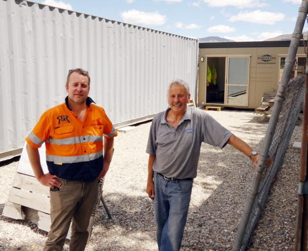 Luke Win (left) of R&R Hiab Services and Cromwell Menz Shed spokesman Dennis Booth discuss the latest developments taking shape at the Menz Shed base, which is now  at the Cromwell Racecourse. Photo: Alexia Johnston